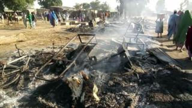 Smouldering ashes and charred items on the ground in Budu, near Maiduguri, after the attack by suspected Boko Haram fighterss on 28 July 2019