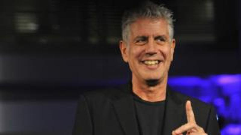 Anthony Bourdain speaks on stage in 2014