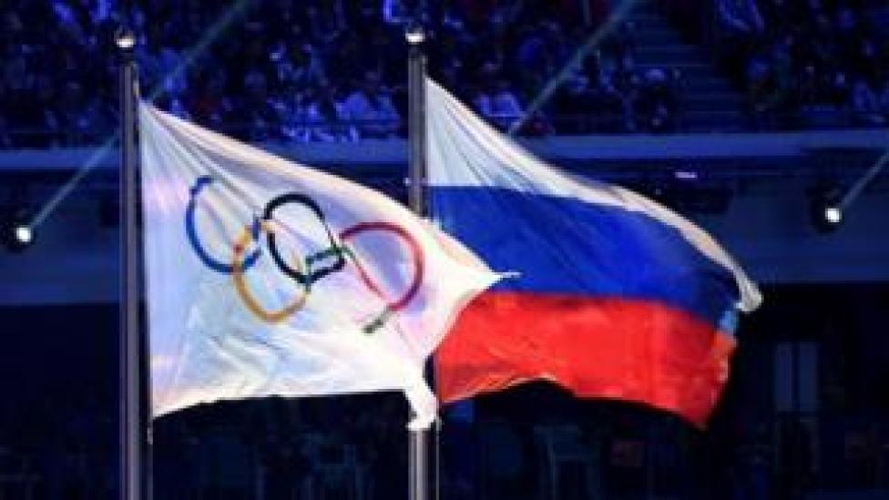 sport Olympic and Russian flags at the Sochi Winter Olympics. Photo: February 2014
