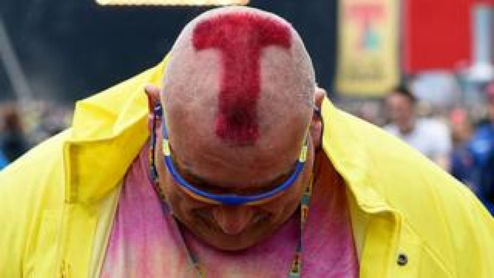 A man with a shaved 'T' in his head