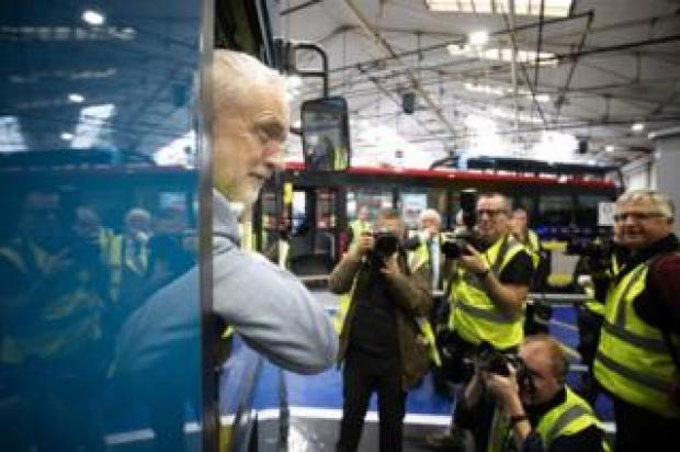 Labour leader Jeremy Corbyn during a visit to the Alexander Dennis bus manufacturer.