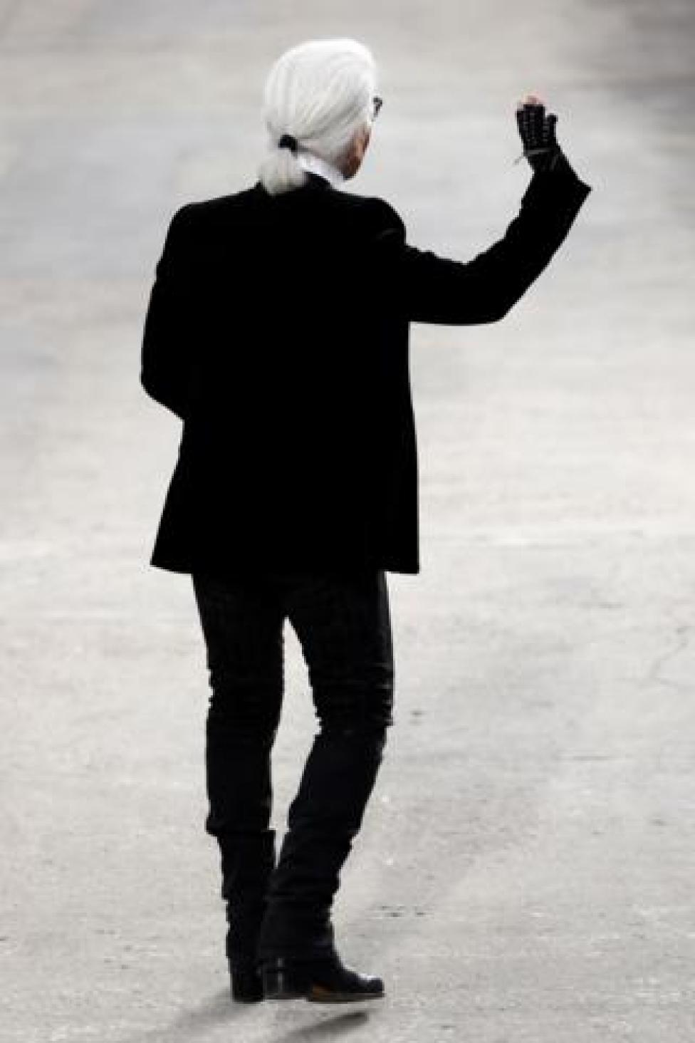German fashion designer Karl Lagerfeld for Chanel acknowledges the public at the end of his 2014 Spring/Summer ready-to-wear collection fashion show at the Grand Palais in Paris.