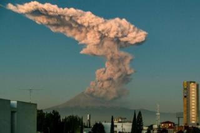 The Popocatepetl Volcano spews ash, rocks and smoke