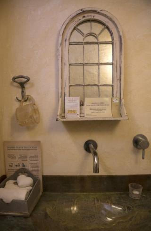 A poster encouraging women to examine themselves for breast cancer is seen in a changing room at a Mikveh outside of Jerusalem. (Photo by Heidi Levine for The BBC).