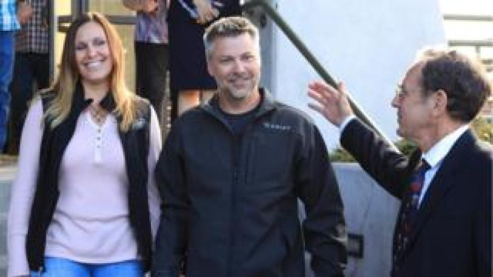 NEWS Josh and his wife Kelli walking out of the courthouse this morning, with Steve Wax