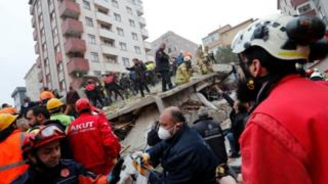 Rescue workers search for survivors at the site of a collapsed residential building in the Kartal district, Istanbul, Turkey, February 6, 2019