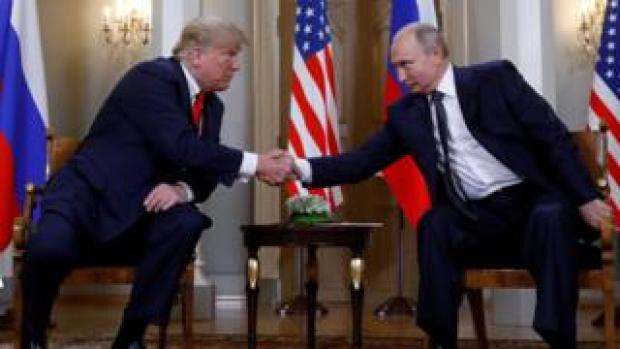 US President Donald Trump and Russia's President Vladimir Putin shake hands as they meet in Helsinki, Finland July 16, 2018