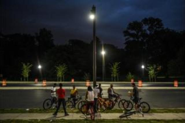 Young people ride their bikes on Reisterstown Rd. outside the parking lot of Hip Hop Chicken in Baltimore, Maryland, U.S., May 26, 2019. Each Sunday the bikers gather to ride their bikes and hang out in a loosely affiliated group of bikers