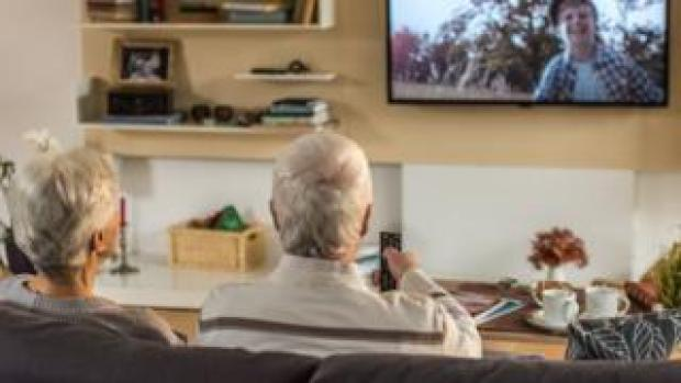 Older people watching TV