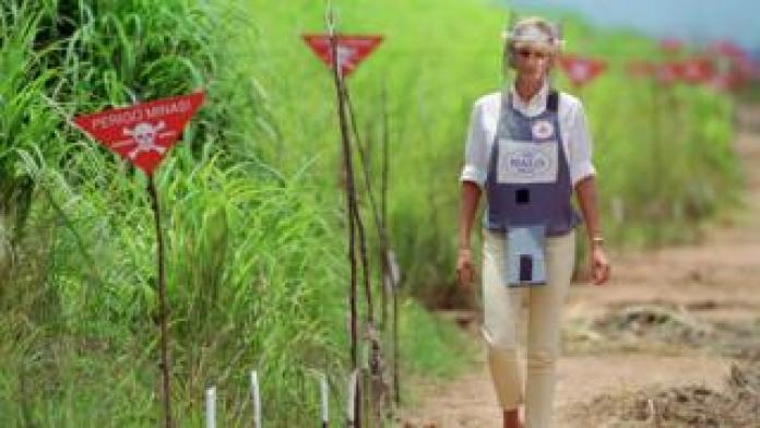 Princess Diana walking through a landmine field in Angola in 1997
