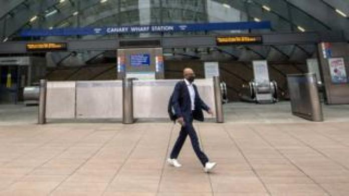 Lone commuter at Canary Wharf station