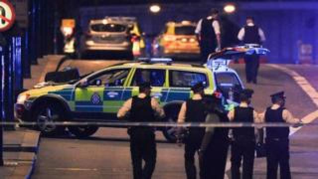 Police officers respond to the London Bridge attack
