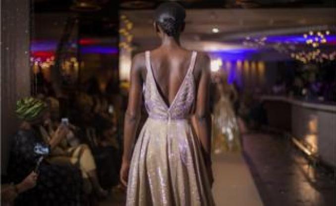 A model walking down the catwalk at the fashion show in Pullman Teranga Hotel during Dakar Fashion Week in Dakar, Senegal