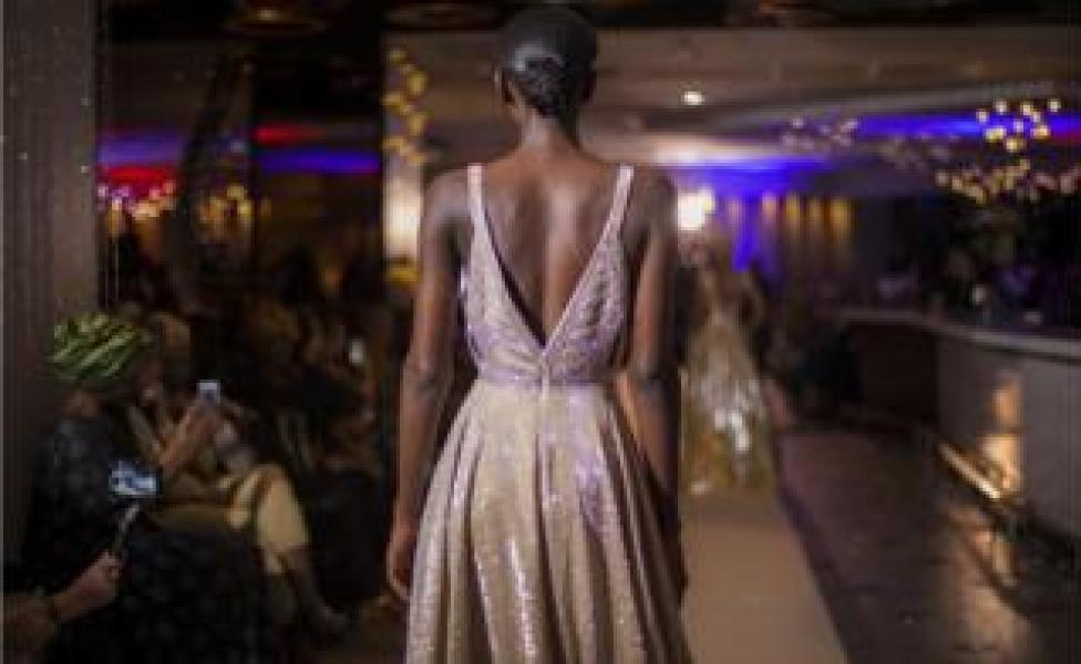 A model walking down the catwalk at the fashion show in Pullman Teranga Hotel during Dakar Fashion Week in Dakar, Senegal