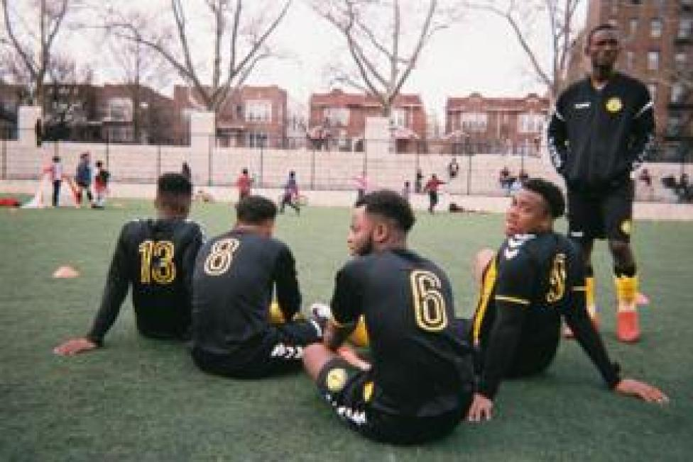 sport Football players sit on the ground on a football pitch