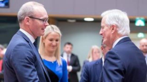 Simon Coveney (left) talking to Michel Barnier