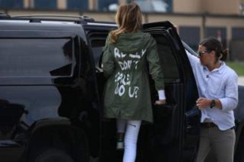 "US First Lady Melania Trump departs Andrews Air Force Base in Maryland 21 June 2018 wearing a jacket emblazoned with the words ""I really don't care, do you?"" following her surprise visit with child migrants on the US Mexico border."