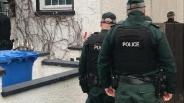 Police officers involved in the raids in east Belfast