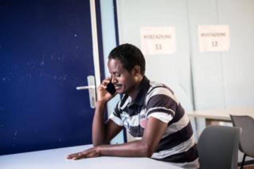 Tesfu speaks on the phone
