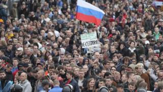 Protesters hold a Russian flag during a demonstration in Moscow on 10 August 2019