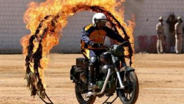 """An Indian Army Jawan (soldier) belonging to the """"ASC Tornadoes"""" daredevil bike team performs during the 71st Republic Day celebrations in Bangalore, India, 26 January 2020."""