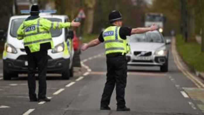 North Yorkshire police officers stop motorists in cars to verify that their journey is