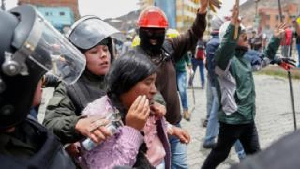 trump Members of the security forces detain a woman during clashes between supporters of Evo Morales and opposition supporters in La Paz, Bolivia, 11 November, 2019.