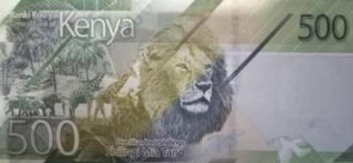 The banknote also shows a lion, giraffes and elephants