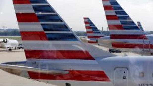 American Airlines aircraft are parked at Ronald Reagan Washington National Airport in Washington, U.S., August 8, 2016
