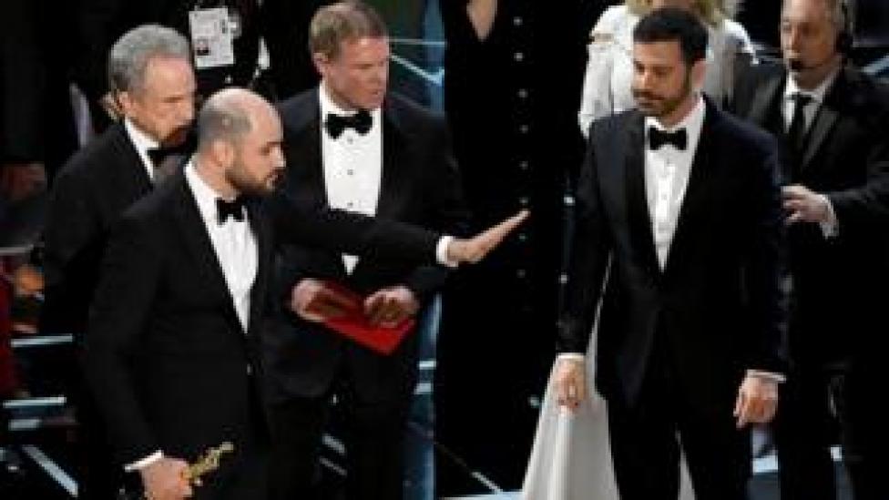 Warren Beatty, La La Land producer Jordan Horowitz and Jimmy Kimmel on stage at the Oscars