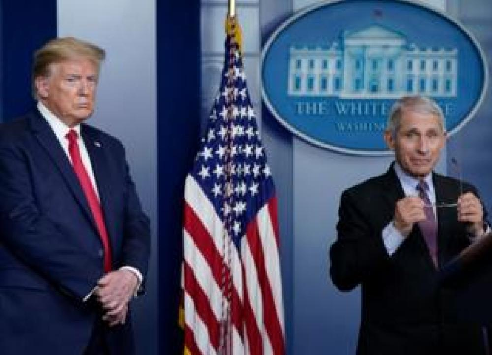 trump Dr Fauci and President Trump speak to the media
