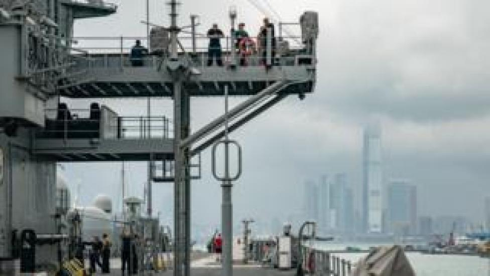 trump Navy crew members of the USS Blue Ridge stand on the deck as the ship is docked at a wharf during a port call on April 20, 2019 in Hong Kong