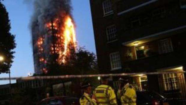 Police man the cordon during Grenfell Tower block fire