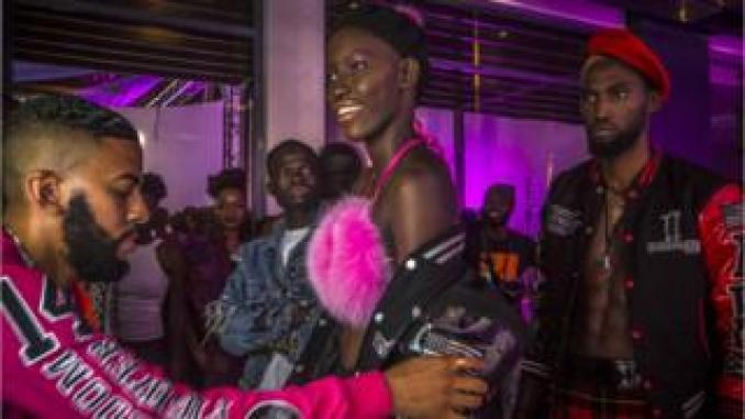 US designer and fashion stylist Mickey Freeman (left) adds his special touch to his creations at Dakar Fashion Week in Dakar, Senegal