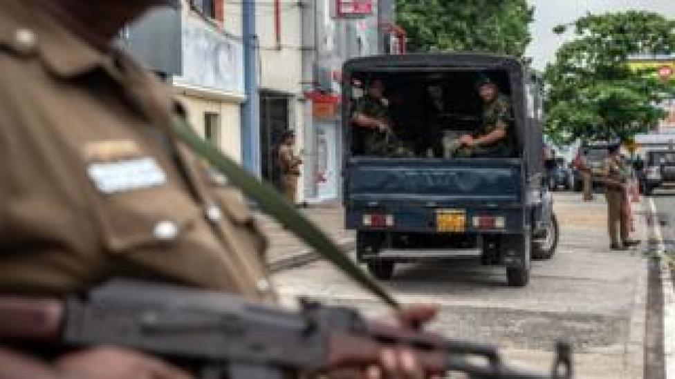 Soldiers and armed police guard the area near Dawatagaha Jumma Masjid ahead of Friday prayers on April 26, 2019 in Colombo, Sri Lanka