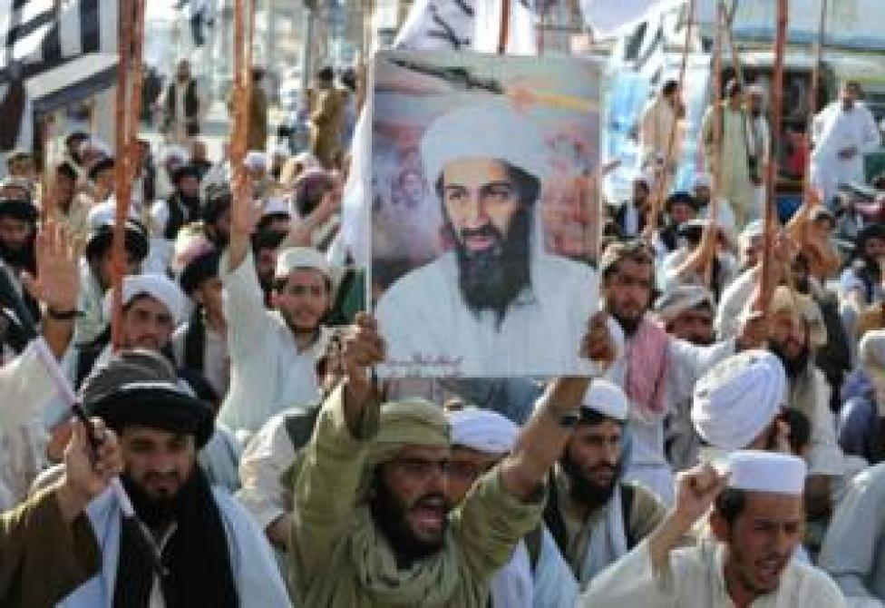 Anti-American protestors holding up a poster of Osama bin Laden in the Pakistani city of Quetta after he was killed by US forces in 2011