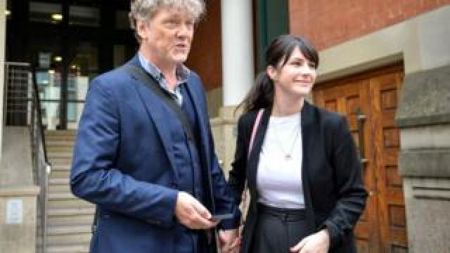 Mark Jordon and Laura Norton outside court