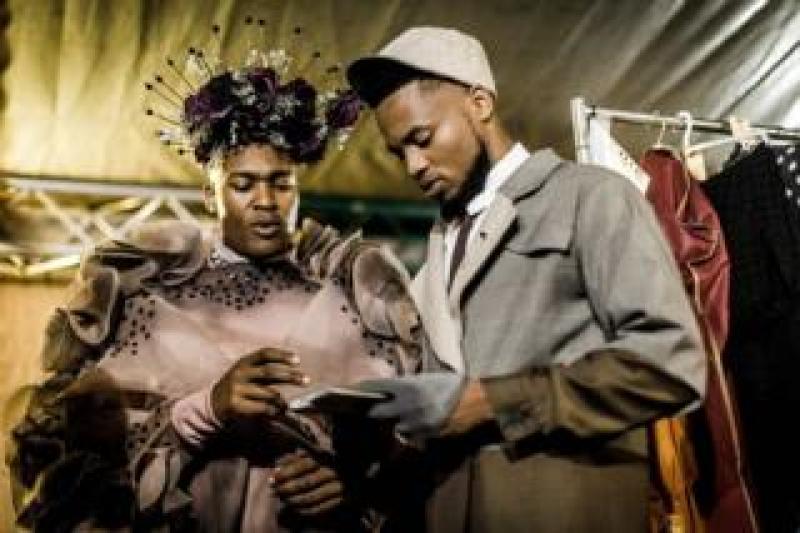 Male models prepare backstage during the fashion preview and concert show for the pre-Durban July Handicap horse race on June 30, 2018 in Durban