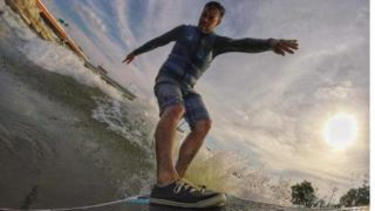 Shannon Thomas surfing in Dayton