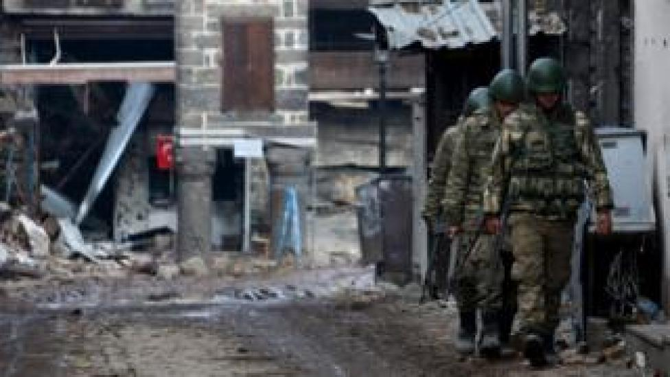 Turkish soldiers patrol in Sur district, which is partially under curfew, in the Kurdish-dominated south-eastern city of Diyarbakir, Turkey February 26, 2016. REUTERS/Sertac Kayar