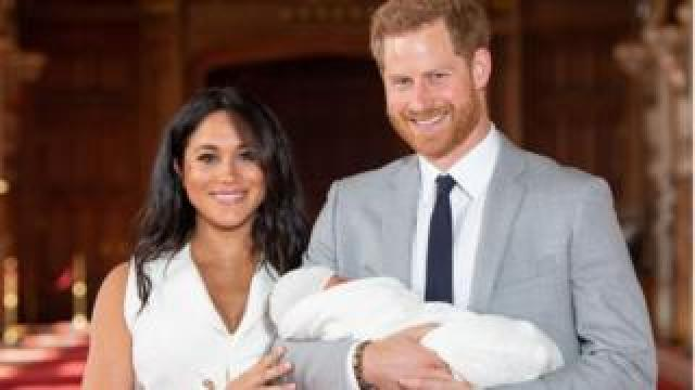 Prince Harry and Meghan holding baby Archie