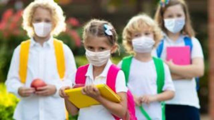 Schoolchildren wearing facemasks