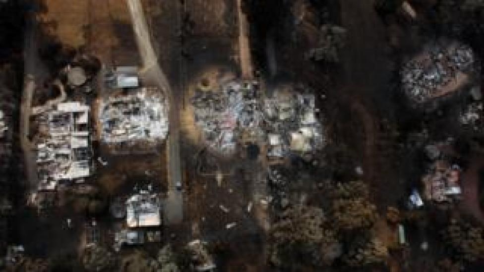 An aerial view of a row of houses in Kinglake shows houses destroyed