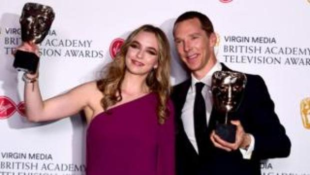 Jodie Comer and Benedict Cumberbatch with their Baftas