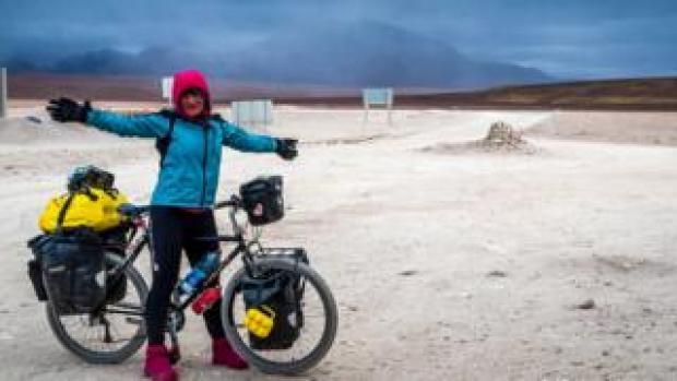 Ishbel with her bike in Brazil
