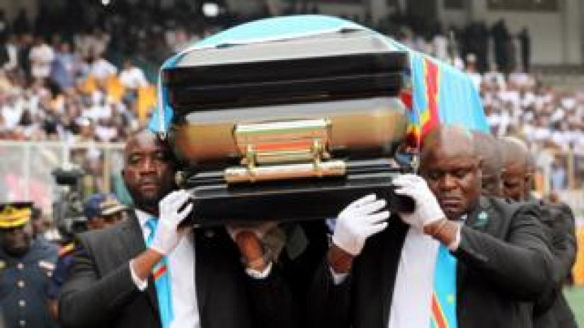 Pallbearers carry the casket with the remains of Etienne Tshisekedi, former Congolese opposition figurehead who died in Belgium two years ago, at a mourning ceremony at the Martyrs of Pentecost Stadium in Kinshasa, Democratic Republic of Congo May 31, 2019.