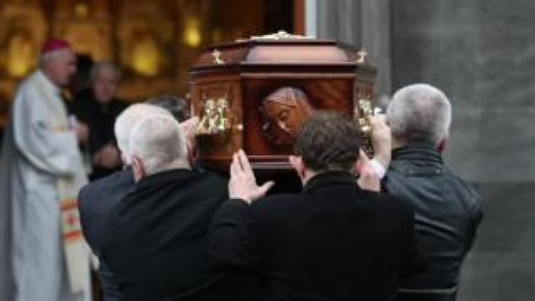 Dolores O'Riordan's coffin is carried into the church by pallbearers