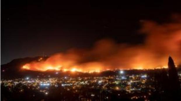 A long exposure photo shows the Maria fire as it races across a hillside in Santa Paula