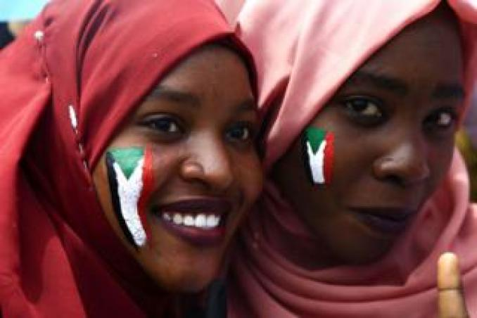 Two smiling Sudanese women