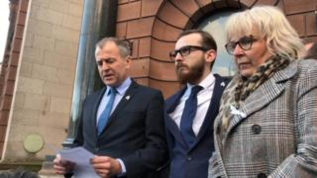 Solicitor Neil Hudgell (l) reading a statement on behalf of Jack and Bernadette Sargeant outside the coroner's court in Ruthin